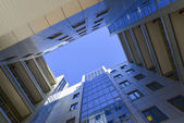 Modern business centre, view from below — Stockfoto