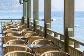 Cafe with wooden tables and chairs at  seaside — Stock Photo