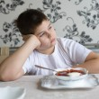Teenager boy do not want to eat soup — Stock Photo #59638015