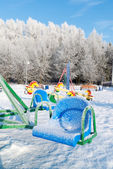 Snow covered swing and slide at playground — Foto de Stock