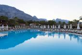 Beautiful pool on  background of mountains in the evening — Foto de Stock