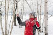 Teenager boy in winter park — Stock Photo