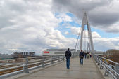 Krasnogorsk, RUSSIA - April 18,2015. Pedestrian bridge is built from two pylons, each measuring 41 m tall. Pylons are connected to spans with help of 28 straight cable wires, which hold up suspension — Stock Photo