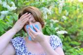 Adult female with allergic rhinitis about bird cherry blossoms — Stock Photo