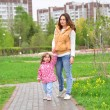 Mother And Daughter Walking Along Path — Stock Photo #73692583