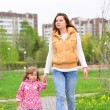 Mother And Daughter Walking Along Path — Stock Photo #73692603