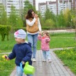 Mother And Daughter Walking Along Path — Stock Photo #73692661