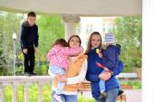 Two mothers with children on the walk in  gazebo — Stock Photo