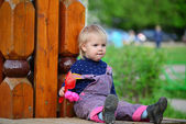 Two year old girl on  park bench — Stock Photo