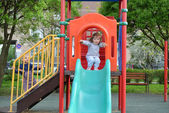 Two little girls playing on  playground — Stock Photo