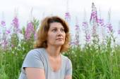 Portrait of  woman near willow-herb in the field — Stock Photo