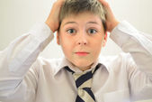 Astonished boy holding his hands behind  head — Stock Photo