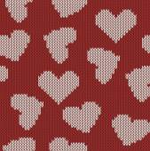 Knitted background with the image of hearts — Stock Vector