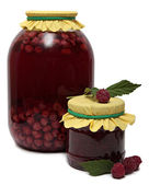 Glass jar of stewed fruit, jam and fresh raspberries. Shot in Studio isolated white background. — Stock Photo
