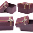 Set of four gift boxes purple with bow and ribbon isolated on white background. — Stock Photo #60672179