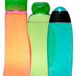 Colored plastic bottles with liquid soap and shower gel. — Stock Photo #60673865