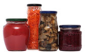Preserved food in glass jars, isolated on white background. Various marinaded — Stock Photo