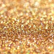 Gold nuggets sparkling carpet. Close-up view, very shallow deep of field . Macro. — Stock Photo #64308207