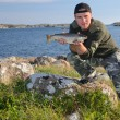 Happy angler with sea trout — Stock Photo #58890803