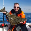 Постер, плакат: Happy angler with halibut fish