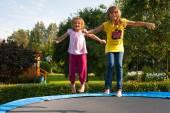 Fun with garden trampoline — Stock Photo