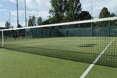 Green tennis court — Stock Photo