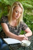 Pretty Blond Girl with Diary — Stock Photo