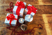 Gift boses and candles for christmas — Stock Photo