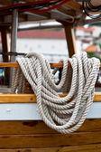 Rope bundle on a wooden boat side — Стоковое фото
