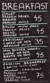 Street cafe breakfast menu written in chalk on a blackboard — Stock Photo
