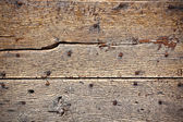 Wooden surface with old metal rivets background — Stock Photo