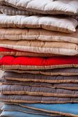Linen chair pillows pile. Vertical outdoor shot — Stock Photo
