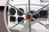 Sailing yacht control wheel and implement. — Stock Photo