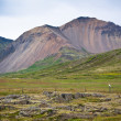 Iceland Caked Lava field and mountains landscape — Stock Photo #57812733