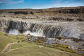 Dettifoss Waterfall in Iceland under a blue summer sky with clou — Stock Photo