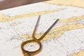 Pair of compasses for navigation on a sea map — Stock Photo
