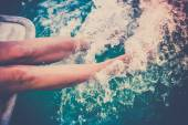Female legs splashing sea water — Foto de Stock
