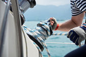 Winch and sailors hands — Stock Photo