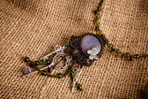 Beautiful handmade necklace with beads — Stock Photo