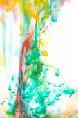 Red and green liquid in water — Stock Photo