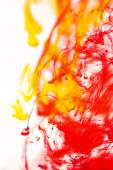 Red and yellow liquid in water — Stock Photo