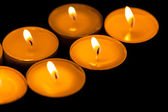 Candles cutting through the darkness — Stockfoto