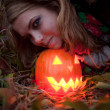 Halloween pumpkins on rocks in a forest at night — Stock Photo #70876543