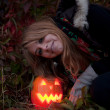 Halloween pumpkins on rocks in a forest at night — Stock Photo #70876445