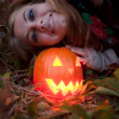 Halloween pumpkins on rocks in a forest at night — Stock Photo #70876523