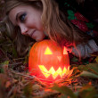 Halloween pumpkins on rocks in a forest at night — Stock Photo #70876533
