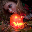 Halloween pumpkins on rocks in a forest at night — Stock Photo #70876541