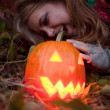 Halloween pumpkins on rocks in a forest at night — Stock Photo #70876567