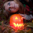 Halloween pumpkins on rocks in a forest at night — Stock Photo #70876581