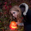 Halloween pumpkins on rocks in a forest at night — Stock Photo #70876599